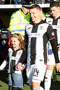 St Mirren midfielder Brad Lyons (14) holds hands with a young female mascot as he takes to the field of play during the Ladbrokes Scottish Premiership match between St Mirren and Hibernian at the Paisley 2021 Stadium, St Mirren, Scotland on 27 January 2019.