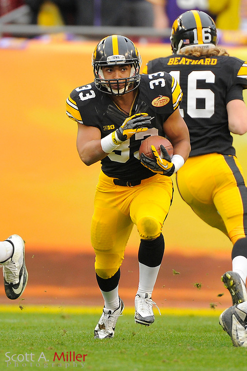 Iowa Hawkeyes running back Jordan Canzeri (33) runs upfield during the LSU Tigers 21-14 win over the Hawkeyes in the 2014 Outback Bowl at Raymond James Stadium on Jan 1, 2014  in Tampa, Florida.            ©2014 Scott A. Miller