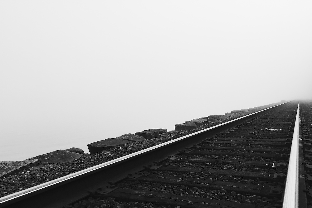 Train tracks in heavy fog by Golden Gardens in Seattle, Washington. Taken with an iPhone