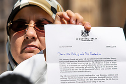 © Licensed to London News Pictures. 10/05/2018. London, UK. Fatima Boudchar holds a letter of apology from Theresa May outside Parliament as Attorney General Jeremy Wright announced that a settlement had been reached over her 2004 rendition to Libya. Fatima Boudchar and her husband, Abdel Hakim Belhaj, were kidnapped in Thailand in 2004 and flown to Libya in a rendition operation, allegedly with the help of MI6. Photo credit: Rob Pinney/LNP