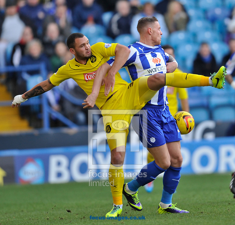Picture by Richard Land/Focus Images Ltd +44 7713 507003<br /> 23/11/2013<br /> Connor Wickham of Sheffield Wednesday and Joel Lynch of Huddersfield Town during the Sky Bet Championship match at Hillsborough, Sheffield.