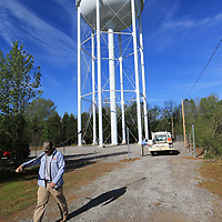 Thomas Wells | BUY at PHOTOS.DJOURNAL.COM<br /> Tupelo Water and Light employee Chris Lewis, left, and Stacey Johnson take the tools they need in order to turn on the water supply for the new water tower on Purnell Road Tuesday morning.