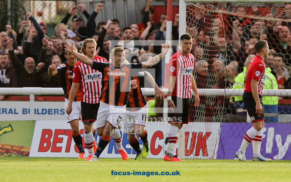 Scott Griffiths (centr left) of Luton Town celebrates scoring his sides first goal during the Sky Bet League 2 match at St James' Park, Exeter<br /> Picture by Tom Smith/Focus Images Ltd 07545141164<br /> 01/11/2014
