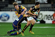 Peter Umaga Jensen of Wellington looks to evade the defence during the Mitre 10 Competition match between Otago and Wellington at Forsyth Barr Stadium on August 25, 2016 in Dunedin, New Zealand. Credit: Joe Allison / www.Photosport.nz