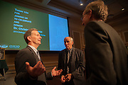 Dr. Christopher France speaks with Mark Halliday and Joe Shields in Baker University Center Ballroom on Tuesday, March 10 after receiving the 2014 Distinguished Professor Award.