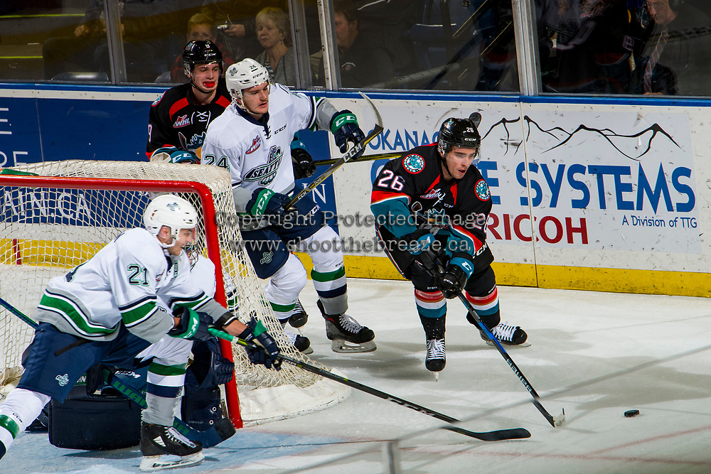 KELOWNA, CANADA - OCTOBER 10:  Liam Kindree #26 of the Kelowna Rockets skates behind the net with the puck away from Jake Lee #24 of the Seattle Thunderbirds on October 10, 2018 at Prospera Place in Kelowna, British Columbia, Canada.  (Photo by Marissa Baecker/Shoot the Breeze)  *** Local Caption ***