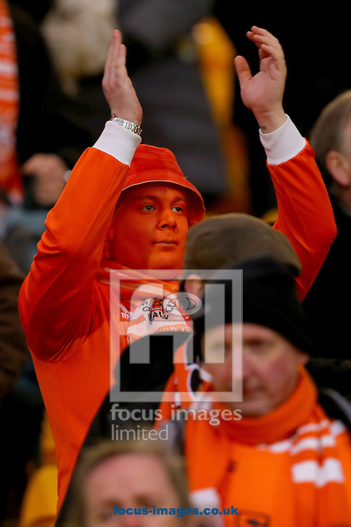 A dejected Blackpool fan applauds his side off the field following the 4-0 defeat to Norwich City in the Sky Bet Championship match at Carrow Road, Norwich<br /> Picture by Richard Calver/Focus Images Ltd +447792 981244<br /> 07/02/2015