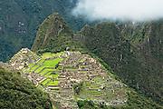 Machu Picchu viewed from the Inka Trail just below Sun Gate; Machu Picchu, Peru.