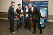 """Jim Sandman (right) shakes the hand of David Zvenyach and his teammates Will Li and David Colarusso at the """"Hackness to Justice 2014 Hackathon"""" session at the 2014 annual meeting of the American Bar Association in Boston at Suffolk University Law School.  photo by Kathy Anderson"""