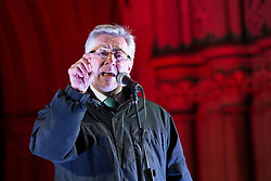 """© Licensed to London News Pictures . 03/02/2015 . Manchester , UK . Greater Manchester Police and Crime Commissioner , TONY LLOYD , speaks at the demonstration . Demonstration organised by the Labour Party on the steps of Manchester City Council in Albert Sqaure , Manchester , under the banner """"manVcam"""" ( Manchester vs Cameron ) . Organisers say Manchester - along with Liverpool and Birmingham - have suffered larger cuts than other regional authorities , whilst southern regions such as Surrey , Hampshire and West Sussex have all seen increases in government funding . Photo credit : Joel Goodman/LNP"""
