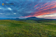 Vivid sunrise clouds above Square Butte and Round Butte in the Highwood Mountains near Coffee Creek, Montana, USA