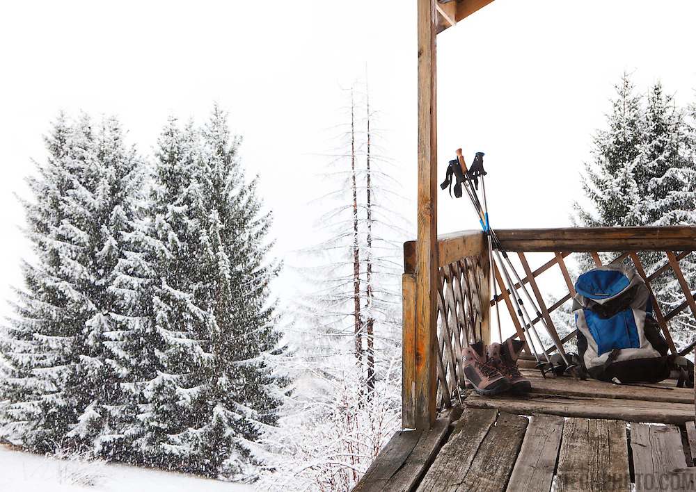 An outdoor winter scene at a cabin in the French Alps.