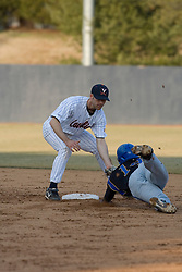 Virginia Cavaliers infielder Tyler Cannon (10) tags out Coppin State Eagles infielder DeShwan Daniel (14) as he was trying to steal second base.  The Virginia Cavaliers Baseball Team defeated the Coppin State Eagles 12-0 at Davenport Field in Charlottesville, VA on February 21, 2007.