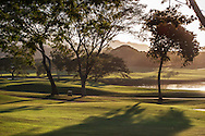 Sunset overlooking the water hazard on the 7th hole of the Robert Trent Jones II golf course at Reserva Conchal Beach Resort, Golf & Spa. The course is located next to the Pacific Ocean on the Costa Rican coast.
