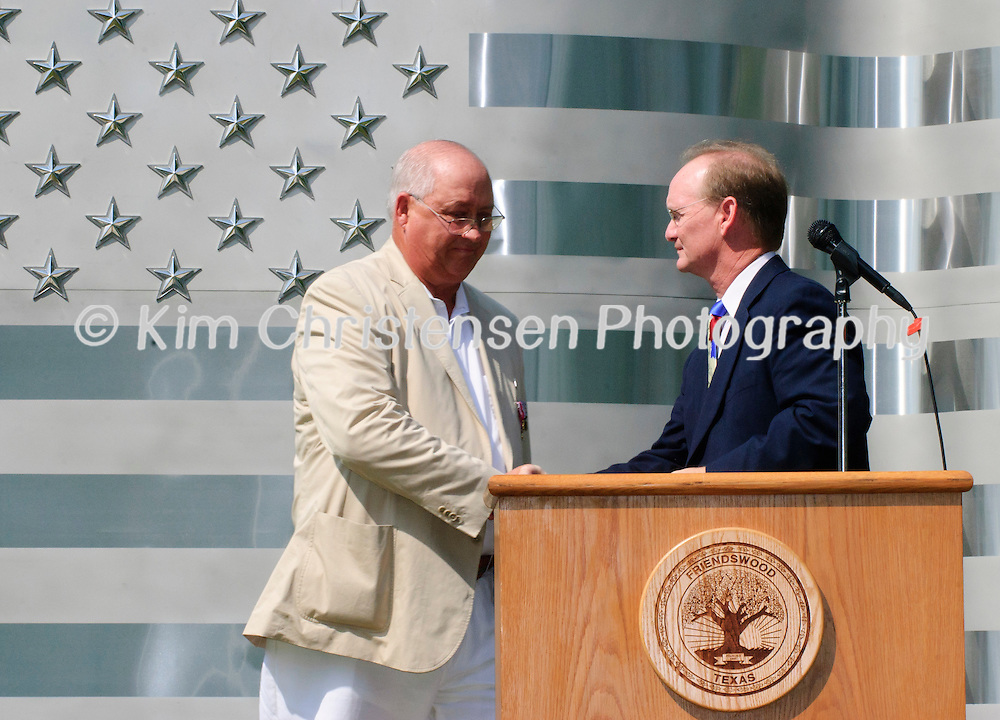 Friendswood City Mayor Daved Smith congratulates  Jay M. Horecky on all his hard work for creating the memorial during the dedication of the new Friendswood Veterans Memorial that was dedicated today.
