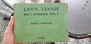 Cover of Lawn Tennis. May I Introduce you? How to play tennis book by Evelyn Dewhurst with sketches by Aubrey Weber. Published in London by Sir Isaac Pitman & Sons in 1940