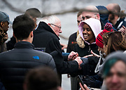Supporters shake hands with Democratic 2020 presidential candidate Bernie Sanders during a rally at James Madison Park in Madison, WI on Friday, April 12, 2019.