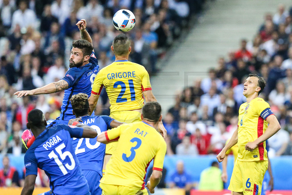 SAINT-DENIS, FRANCE, 10.06.2016 - FRANCE-ROMANIA - Olivier Giroud (E) of France and Dragos Grigore of Romania, in a match valid for the 1st round of Group A of Euro 2016 in the Stade de France in Saint-Denis, Friday (10).