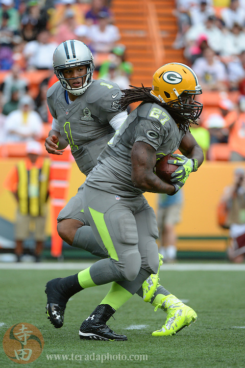 January 26, 2014; Honolulu, HI, USA; Team Sanders quarterback Cam Newton of the Carolina Panthers (1) hands the football off  to running back Eddie Lacy of the Green Bay Packers (27) during the third quarter of the 2014 Pro Bowl at Aloha Stadium. Team Rice defeated Team Sanders 22-21.