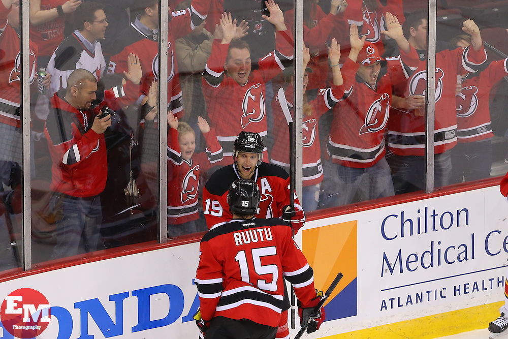 Mar 31, 2014; Newark, NJ, USA; New Jersey Devils center Travis Zajac (19) and New Jersey Devils left wing Tuomo Ruutu (15) celebrate Zajac's hat trick goal during the third period at Prudential Center. The Devils defeated the Panthers 6-3.