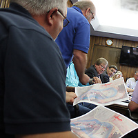 RAY VAN DUSEN/BUY AT PHOTOS.MONROECOUNTYJOURNAL.COM<br /> Maps of a proposed cell expansion at the Monroe County Landfill are passed around the table at the board of supervisors' Friday meeting.