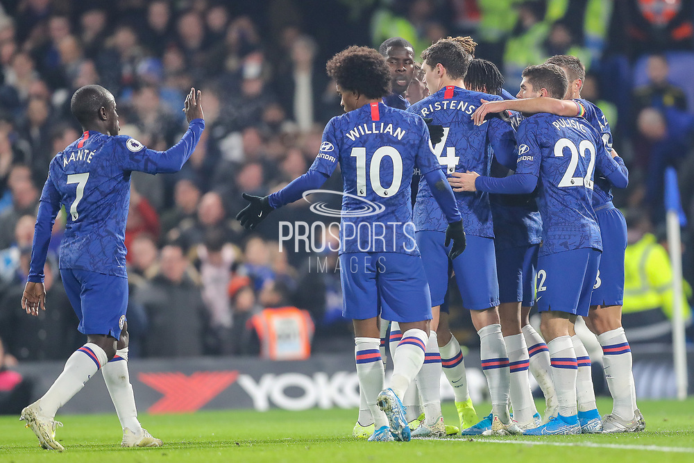 Chelsea forward Tammy Abraham (9) celebrates with teammates after scoring a goal (1-0) during the Premier League match between Chelsea and Aston Villa at Stamford Bridge, London, England on 4 December 2019.