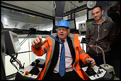 Mayor of London visit to DP World London Gateway.<br /> The Mayor of London, Boris Johnson during a visit to the DP World London Gateway site to see for himself the progress made on its construction and to discuss the benefits the port will have for London,<br /> Essex, United Kingdom<br /> Tuesday, 30th July 2013<br /> Picture by Andrew Parsons / i-Images