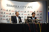 Swansea city chairman Huw Jenkins (l) with Michael Laudrup. Michael Laudrup is officially announced as the new Swansea city FC manager at a press conference at the Liberty Stadium in Swansea, South Wales on Thursday 21st  June 2012. pic by Andrew Orchard, Andrew Orchard sports photography,