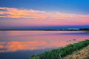 Sunset with grain bins and water<br /> Tuxford<br /> Saskatchewan<br /> Canada