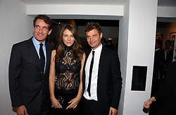 Left to right, TIM JEFFERIES, LIZ HURLEY and MARC HOM at a private view of an exhibition of portrait photographs by Danish photographer Marc Hom held at the Hamiltons Gallery, 13 Carlos Place, London on 23rd October 2006.<br /><br />NON EXCLUSIVE - WORLD RIGHTS
