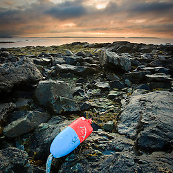 A lobster buoy on the rocks at Seawall in Maine's Acadia National Park.