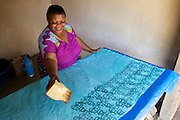 Asia Diwala making a new Batik.<br /> <br /> Asia owns and runs a Batik business in KwaMatias, Tanzania.<br /> <br /> She attended MKUBWA enterprise training run by the Tanzania Gatsby Trust in partnership with The Cherie Blair Foundation for Women.
