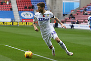 Leeds United midfielder Mateusz Klich (43) goes through to getbthe assist forthe goal 1-1 during the EFL Sky Bet Championship match between Wigan Athletic and Leeds United at the DW Stadium, Wigan, England on 4 November 2018.