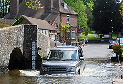&copy; Licensed to London News Pictures.04/05/2018<br /> EYNSFORD, UK.<br /> Photo credit:Grant Falvey/LNP<br /> A Land Rover gets wet in Eynsford Ford.<br /> The Start of the May Bank holiday weekend today as people enjoy a relaxing day in Eynsford, Kent.