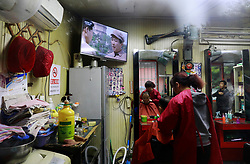 epa06264980 A television set shows a series featuring former Chinese Communist leader Mao Zedong, as a man gets a haircut in a barber shop in Beijing, China, 14 October 2017. The Communist Party of China (CPC) is making preparations for the five-yearly 19th National Congress scheduled to begin next week on 18 October. During the Congress members will elect a new Central Committee, including a new 24-member Politburo and a new seven-member Standing Committee.  EPA-EFE/HOW HWEE YOUNG
