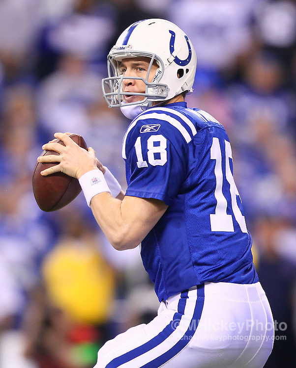 Jan. 08, 2011; Indianapolis, IN, USA; Indianapolis Colts quarterback Peyton Manning (18) drops back to pass against the New York Jets during the 2011 AFC wild card playoff at Lucas Oil Stadium. Mandatory credit: Michael Hickey-US PRESSWIRE