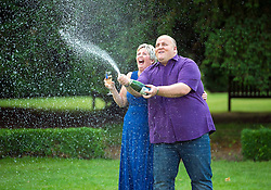 © Licensed to London News Pictures. 14/08/2012 Hatfield Heath, UK. .Euromillions lottery winners Adrian and Gillian Bayford from Haverhill, Surrey celebrate their win at the Down Hall Country House Hotel. The pair banked the second biggest UK lottery win of £148,665.00. Photo credit : Simon Jacobs/LNP
