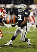 Oakland Raiders defensive end Justin Tuck (91) rushes during the NFL week 12 regular season football game against the Kansas City Chiefs on Thursday, Nov. 20, 2014 in Oakland, Calif. The Raiders won their first game of the season 24-20. ©Paul Anthony Spinelli