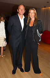 INDIA HICKS and DAVID FLINT WOOD at a party at The Sanderson Hotel, Bernnnnners Street, London in aid of Sargent Cancer Care for Children on 7th July 2004.