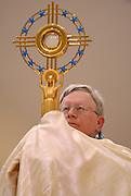 Green Bay Bishop David Ricken raises a monstrance holding the Blessed Sacrament. (Sam Lucero photo)