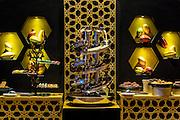 DUBAI, UAE - DECEMBER 18, 2015: Chocolate fountain at the Al Hambra restaurant at Jumeirah Al Qasr, Madinat Jumeirah Resort.
