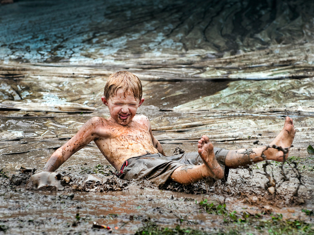 Nick Mertens with Cub Scout Pack 983 in Warrenton enjoyed a fun ride on a water-turned-mud slide.