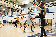Mount Mansfield forward Lexi Mousley (15) guards Rice guard Jordan Lawrence (11) as she tries to throw the ball in bounds during the girls basketball game between the Rice Green knights and the Mount Mansfield Cougars at MMU High School on Friday night December 4, 2015 in Jericho. (BRIAN JENKINS/for the FREE PRESS)