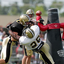 04 August 2009: Saints linebacker Scott Fujita over powers running back Reggie Bush (25) on a pass protection drill during New Orleans Saints training camp at the team's practice facility in Metairie, Louisiana.