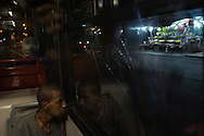 In this pictures: He's from Eritrea, this is his last night-Bus through the city of Rome to reach Termini Station, since then it will be just an all night long travel to Bolzano (near the Italian-Austrian border) by train.<br /> The number of migrants arrived in Italy by boat in 2015 is now (July) above 50.000, the Italian Interior Ministry said. The majority of them are migrants and asylum seekers rescued in the Mediterranean sea attempting to reach Italy in order to to join relatives or find a job in northern Europe. Italy actually is facing an increasing stream of migrants who try to get to Germany or Scandinavia by train traveling through Austria. They start their travel to the Italian border from the Baobab Center. The majority of them are coming from troubled countries such as Eritrea and Sudan, and all of them have managed a long and dangerous journey through deserts and seas to escape wars, dictatorships and poverty.