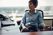 BIRMINGHAM, AL –MARCH 18, 2016: A white collar female executive works in an office environment.