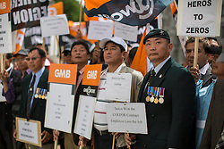 © licensed to London News Pictures. London, UK 07/08/2013. Former members of the Gurkha regiment who are employed by Serco staging a protest over potential changes to pay and conditions outside Ministry of Defence in London. Photo credit: Tolga Akmen/LNP