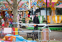 © Licensed to London News Pictures. 04/11/2018. Woking, UK. Police remain at the site of a deflated slide in Woking Park after it collapsed injuring eight children. The park was holding a fireworks party when the accident happened. Photo credit: Peter Macdiarmid/LNP