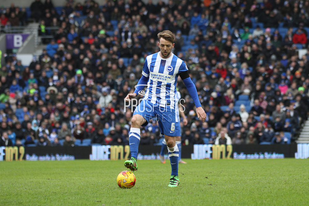 Brighton central midfielder, Dale Stephens (6) traps the ball during the Sky Bet Championship match between Brighton and Hove Albion and Bolton Wanderers at the American Express Community Stadium, Brighton and Hove, England on 13 February 2016. Photo by Geoff Penn.