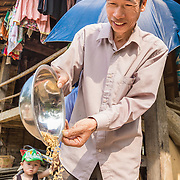 "CAPTION: ""Before, our only option was to sell to a merchandiser"", Chung says. ""Their prices changed a lot, and we never knew whether we were getting a good price or a bad price"". He became a member of Cooperative Huy Tuong II in 2012. Selling his surplus produce directly to the cooperative means he able to bypass the merchandiser and receive a fairer, more stable price. The cooperatives have established reliable transportation links between Huy Tuong and Hanoi; after buying and processing, the produce it is sent on a local bus. LOCATION: Coong Village, Huy Tuong, Son La Province, Vietnam. INDIVIDUAL(S) PHOTOGRAPHED: Vi Van Chung."